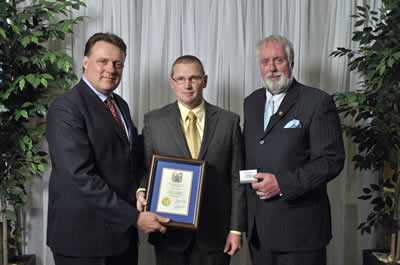 Councillor David Hendsbee and Mayor Mike Savage present a 2013 Volunteer Award to Brian Veniot.