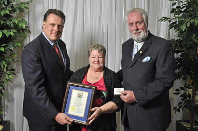 Councillor David Hendsbee and Mayor Mike Savage present a 2013 Volunteer Award to Evelyn Hatch.