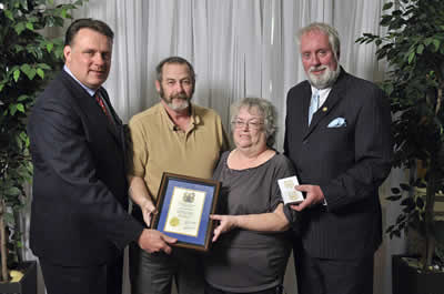 Councillor David Hendsbee and Mayor Mike Savage present a 2013 Volunteer Award to Len & Jean Milne.