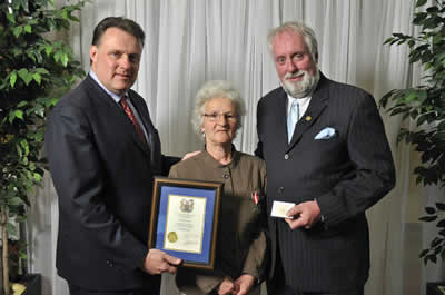 Councillor David Hendsbee and Mayor Mike Savage present a 2013 Volunteer Award to Lorna George.