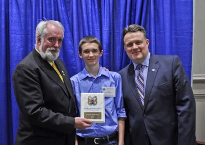 Councillor David Hendsbee and Mayor Mike Savage present a 2014 Citizenship Award to Justin Thornhill.