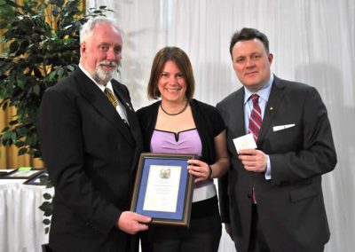 Councillor David Hendsbee and Mayor Mike Savage present a 2014 Volunteer Award to Stefanie Condon-Oldrieve.