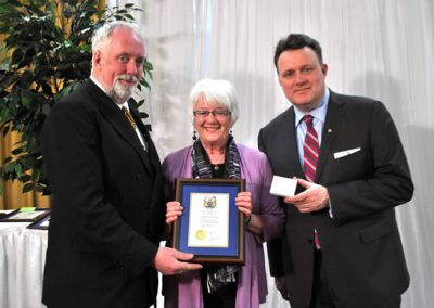 Councillor David Hendsbee and Mayor Mike Savage present a 2014 Volunteer Award to Valeria Greenwood.