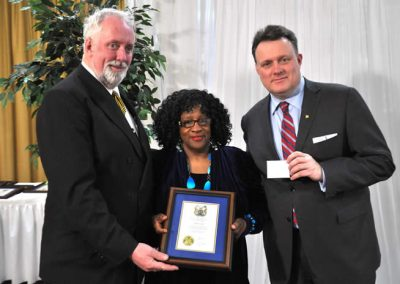 Councillor David Hendsbee and Mayor Mike Savage present a 2014 Volunteer Award to Vivian Cain.